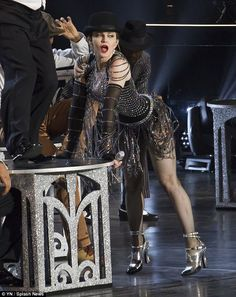 Putting on a show: As is her style, Madonna didn't hold back during the performance, at one point twerking in a tiny, black ensemble covered in chains of dangling jewels Madonna Now, Madonna Rare, Madonna And Child, Madonna Music Videos, Madonna Quotes, Divas, Madonna Concert, Madonna Fashion, Ballerinas