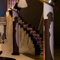 Add an extra staircase to add more volume and symmetry to your theme.