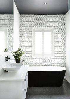 black tub, white bathroom