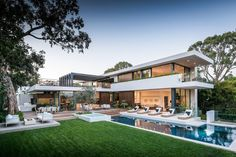 This home in the Pacific Palisades area of California, is designed for outdoor entertaining, with a large backyard, with swimming pool, outdoor kitchen and dining area, outdoor fireplace, and sun deck!