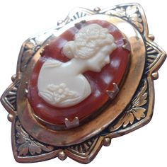 Vintage Cameo Pin Art Deco Setting With Plastic Cameo. https://www.pinterest.com/rubylanecom/vintage-jewelry-under-25/
