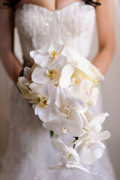 Cascading Orchid Bouquet | photography by http://www.susanstripling.com | wedding planning by http://www.angweddingsandevents.com/ | floral design by http://ovandony.com/
