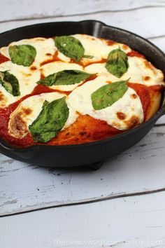 Here we have a deep dish margherita skillet pizza. This pizza was thick, yummy, and filling! You can use store bought dough, but this homemade pizza dough recipe is incredibly easy, uses every day ingredients, rolls out much easier, and tastes way better!