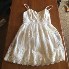 Cream lace dress American eagle, size medium with adjustable straps, never worn dress! This is so cute, I just wish I wasn't so short! No tears or stains, not see through either (multiple layers to prevent that!) American Eagle Outfitters Dresses Mini
