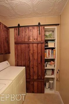 Sliding barn door.....except painted black for our master bathroom......