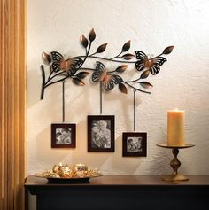 The most lovely way to display three of your favorite family photos! A trio of wood picture frames hang from a metallic branch blooming with leaves and home to three gorgeously detailed butterflies. This fabulous wall décor will turn your favor. Picture Frame Decor, Hanging Picture Frames, Frame Wall Decor, Wood Picture Frames, Metal Wall Decor, Picture On Wood, Metal Wall Art, Frames On Wall, Framed Wall Art