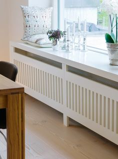 Use these radiator cover ideas to transform your room. See how to use a radiator cover for storage, reading nooks under windows, corner cabinets + more. Decor, Radiator Cover, Home And Living, Furniture, Home Living Room, Home Radiators, Interior, House Interior, Home Deco