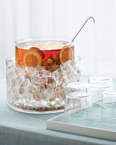 Instead of watering down your punch bowl with ice cubes, slip one glass container inside another and fill the outside one with ice!