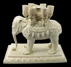 An important and very rare white-glazed 'elephant' candle stand, Sui-early Tang dynasty, century - Alain. Elephant Pictures, Calligraphy Pens, Candle Stand, Asian Art, Amazing Art, Lion Sculpture, Ivory, Carving, Pottery