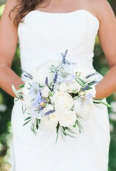 romantic bouquet comprised of white peonies, muscari, and greenery