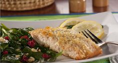 Salmon fillets coated with seasoned potato flakes - it's so easy to do, and the crunchy coating really makes this salmon taste extra-special. And pine nuts and olive oil give basic wilted spinach a blast of class.