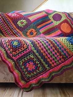 This vintage inspired afghan is a modern take on the retro granny square blanket of the 70's. It combines classic crochet stitches and motifs with lots of vivid colors for a home accessory that makes a statement. Groovyghan is easy to customize with more a fewer colors and even different crochet motifs. For a really funky blanket, use up remnants in various colors and fibers!