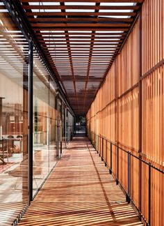 The walkway between the glazed structure and slatted wood gives the house its name, Engawa, which is the wooden edging strip typically found in Japanese architecture.