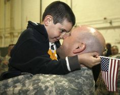 Adam Movshin, 7, of Hillsborough, hugs his father, Major Robert Movshin, 38, after the ceremony. Major Movshin is among the soldiers being deployed to Afghanistan. (Patti Sapone/The Star Ledger)