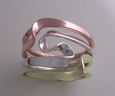 Three Metals 4 Turn Vortex Energy Ring by isidro on Etsy, $265.00