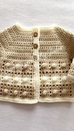 Beautiful Beige And Cream Cardigan is now available from my Etsy Shop Crochet Baby Sweaters, Knit Baby Dress, Crochet Cardigan Pattern, Knit Crochet, Baby Sweater Patterns, Baby Knitting Patterns, Crochet Patterns, Layette Pattern, Crochet Video