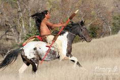 A Native American, Lakota riding horseback in the prairie of South Dakota | Nancy Greifenhagen