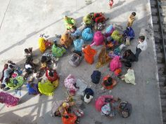 India- I saw these beautiful people and colors waiting for the train to Agra.