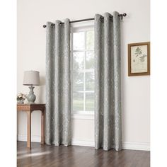 The Hagen curtain panel by No. 918 features a beautiful watercolor print in a cool grey tone that will dramatically update your room with a fresh look.