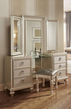 My Diva #Vanity #Dresser & Stool has a platinum finish, a tri-view #mirror, and an upholstered stool with hidden storage. The spacious drawers are decked out with fancy hardware, felt lined top drawers and even cedar lined bottom drawers!