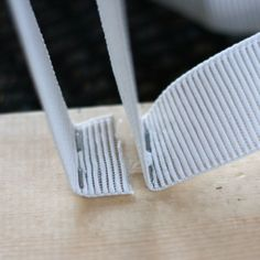 step 3   Picture of Staple the elastic to the board