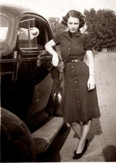 Young lady by the car in wartime outfit, 1940's