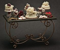 So gorgeous. The details are amazing on this miniature cake table! Miniature Kitchen, Miniature Crafts, Miniature Food, Miniature Dolls, Pink Dollhouse, Dollhouse Miniatures, Miniature Furniture, Dollhouse Furniture, House Cake