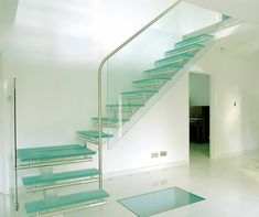 Give your stairs a step up with these genius staircase decorating and design ideas, from floating stairs and under-stair offices to wallpapered steps. Glass Stairs, Floating Stairs, Staircase Railings, Staircase Design, Staircases, Staircase Ideas, Spiral Staircase, Modern Hallway, Modern Stairs