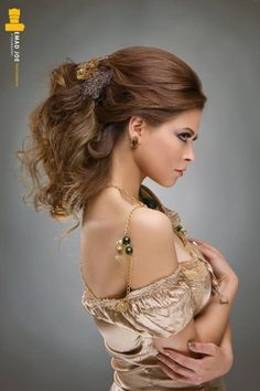 When it comes to capturing the essence of a sexy and messy formal hairdo Emad Joe sure knows how to do just that! What is amazing about this hairstyle is the way the hair looks so natural and flows in such a nice voluminous way and still looks elegant. To add to this already cool and creative formal hairstyle it is pinned down with a beautiful rustic hair pin which really works well with this medieval look.