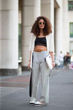 Curls are in and so are slouchy pants! Two 90s trends we're very happy to revisit.  Love these high waisted pants paired with barely there crop top on the streets of Milan during Milan Fashion Week SS16.