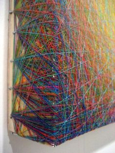 Emil Lukas creates – what he calls – paintings with thread: criss-crossed thread…