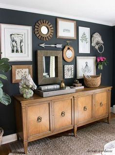 Eclectic gallery wall with a mix of art, hooks to hand flowers, and a mirror kellyelko.com
