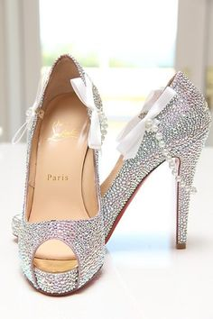DIY Christian Louboutin Idea  What a great idea! This bride added shoe clips onto her beautiful Louboutin's. Strand of pearls and bows are perfect!