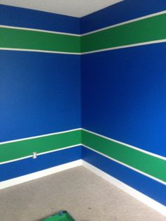 Painted Jesse's room Vancouver Canucks colours... Blue and Green Bedroom