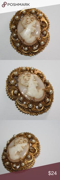 Estate Cameo Florenza Brooch or pendant *seed pearl is missing, minor wear to the gold tone on the top* Beautiful collectible piece.  about 1.5 inches tall Buy from me with confidence! I have sold over 400 items with a 5 star rating! If you have any questions, do not hesitate to ask.  Looking at a few things in my shop? Put a bundle together, comment on an item that you are ready to check out and let me send you an even better offer!  Thank you for visiting :) Free gifts with every purchase…