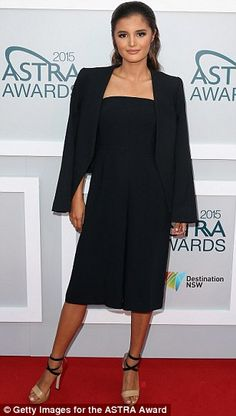 Stylish: Presenter Naomi Sequeira rocked a simple strapless gown and cape...