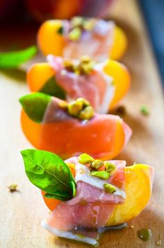 2 peaches 4 slices Parma ham ¼ cup roasted pistachios chop 1 tbsp white balsamic vin basil oil: 1 c. basil leaves ½ c. olive oil -Blanch basil in boiling salted water for 10 sec then into ice bath. dry. basil in blender w oil, puree. Strain mixture and let the flavors develop