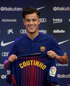 New Barcelona signing Philippe Coutinho poses for a photograph with his new shirt as he is unveiled at Camp Nou on January 8, 2018 in Barcelona, Spain. The Brazilian player signed from Liverpool, has agreed a deal with the Catalan club until 2023 season.