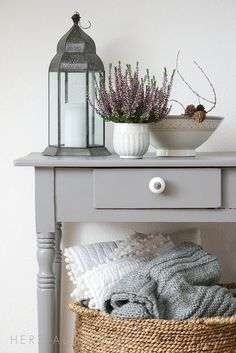 love the warm grey with white and natural i.e. timber floors, basket, jute, sisal… and a splash of green!