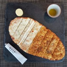 Osia Steak and Seafood Grill's Stone Hearth Flatbreads are freshly baked upon order. Our recommendation: try it with their signature 'toothpaste' tube dips for a gastronomical experience!