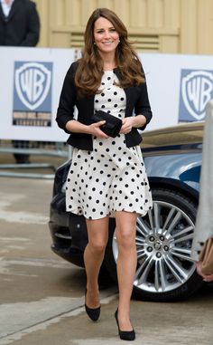 E! Online - Best Looks of the Week - Kate Middleton: The royal mom-to-be dressed her baby bump in a polka dot Topshop dress with a classic Ralph Lauren blazer for a visit to Warner Bros. film studio in Leavesden, England. She accessorized her maternity style with black suede pumps and a chic box clutch.