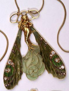 An Art Nouveau dragonfly woman pendant, by René Lalique. Gold, diamond, plique-à-jour enamel.