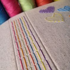Tê Pires colorful rainbow long stitch bookbinding