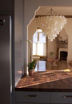 Butcher block counters and statement lighting #kitchen #lights #grey via Design Sponge