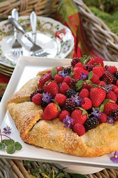 Beautiful edible flowers and fresh berries bring color and flavor to this Summer Berry Galette.