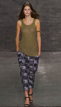 Edun brand works with a group of African nuns for their crochet pieces. The Spring/Summer 2013 runway show featured crochet tanks and dresses in military green hues.