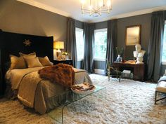 Like the lucite bench/table at the foot of the bed but I LOVE  the wall to wall plush carpet.