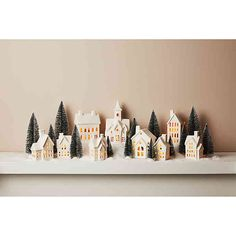 Bask in the glow of a classic Christmas scene with this beautiful Porcelain Village. This set displays a village of adorable, snow-capped cottages that dazzle and glow with the included LED tea light to make your Christmas merry and bright. White Christmas Tree Decorations, White Christmas Trees, Christmas Village Display, Christmas Villages, Winter Christmas, Christmas Themes, Christmas Crafts, Christmas Village Houses, Christmas Tablescapes