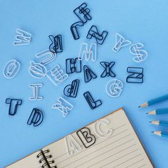 Clip the pages of your favorite book with these alphabet paper clips.