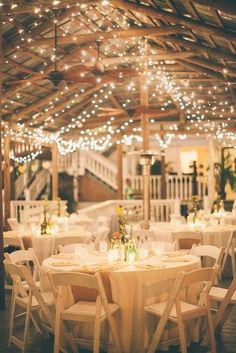 Rustic wedding reception decor with hanging lights
